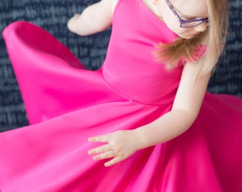Audriella Girls Dress with boatneck front and full circle skirt. Girls Sizes 2-16. Instant download PDF sewing pattern.