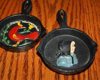 Vintage Cast Iron Souvenir Spoon Rests (2) - Amish Woman and Dutch Wonderland