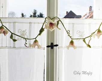 Garland in white and pink very fine decoration for the home, windows or party. Full enchanting in the room with Kids