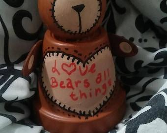 Bear, love bears all things