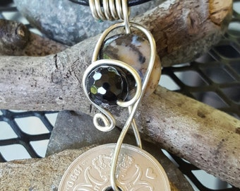 Denmark Coin Wire Wrapped in Nickel Silver Beads  Jasper  and Black Onyx On a black Leather Cord