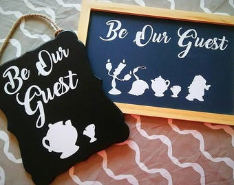 Your choice of 'Be Our Guest' chalkboard signs