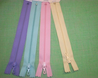 Set of 4 closures zipper 25 cm assorted pastel colors pink, purple, yellow and green