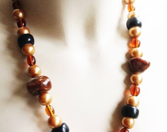 Necklace - A chunky amber plastic necklace light and dark amber beads retro design with gorgeous large plastic beads