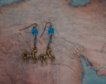 A pair of earrings with horse charms