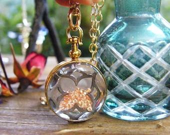 gold oval memory glass locket photo locket heirloom keepsake necklace 14 karat gold fill with champagne sparklers