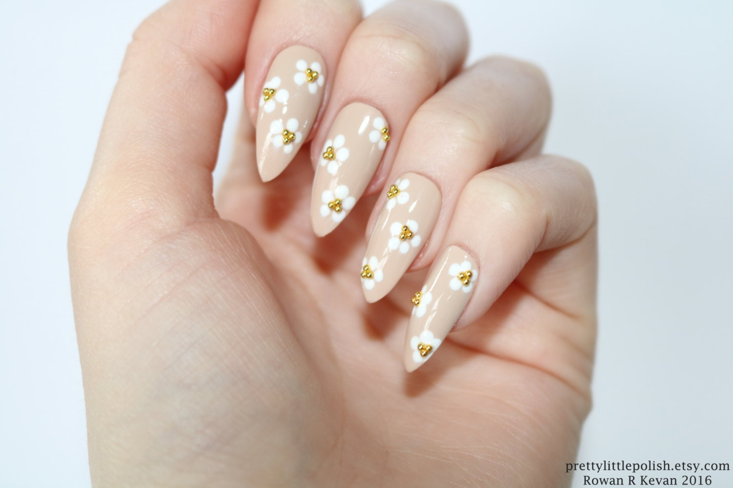 Floral stiletto nails Nude stiletto nails Nude nails