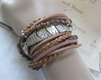 Boho Leather and Adorable Silver fish Wrap Bracelet, Multi Strands of Leather and beads in shades of natural browns, tans and silver!