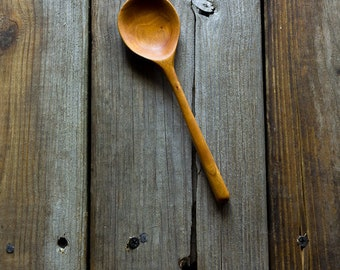 Wooden condiment and sauce serving spoon in Vt red birch wide bowl and 5 inch squared handle sanded smooth