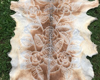 Tan and cream hand carved goat hide