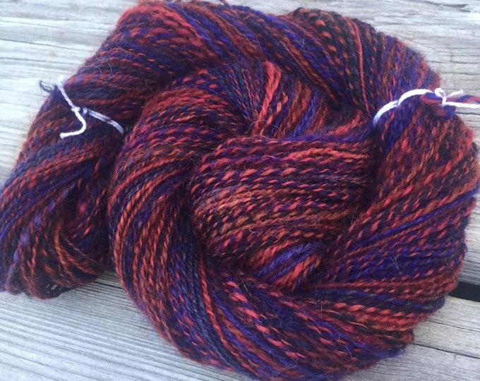 Depth of Love Handspun Yarn Sport Weight 2 ply wool yarn FiberTerian 138 yards red rust electric blue brown black