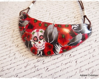 Made entirely of polymer clay skull and poppy bib necklace. Skull necklace