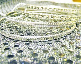 Set of 4 silver Bangle Bracelets