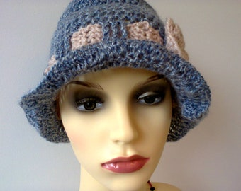 Cloche crochet hat for women, frilly brim in faded bluewool with a  pale crocheted ribbon and flower.