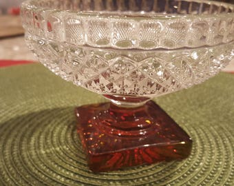 Vintage crystal dish with red glass stem