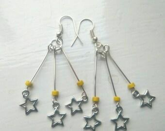 Yellow star burst earrings