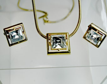 Avon Gold Tone Rhinestone Necklace and Matching Clip On Earrings