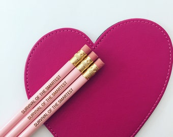 survival of the smartest pencil set in pastel pink, engraved pencils for your favorite smarty-pants.