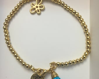 gold plated bracelet with charms and tassel
