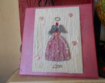 Natural Rose Quartz Angel of Love on canvas.