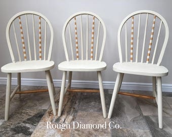 Set of three upcycled and hand painted chairs