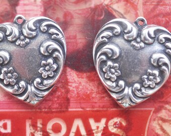 TWO Victorian  brass heart charms with flowers, Sterling Silver Finish, brass stampings made in the usa