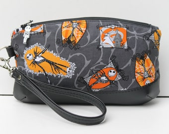 Clematis Clutch with wrist strap, done in Nightmare Before Christmas fabric Jack Skellington pouch