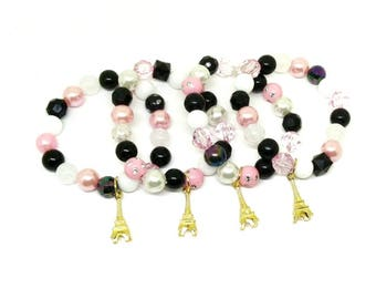 Gold Paris Eiffel Tower bracelets party favors in organza bags with special birthday girl bracelet!