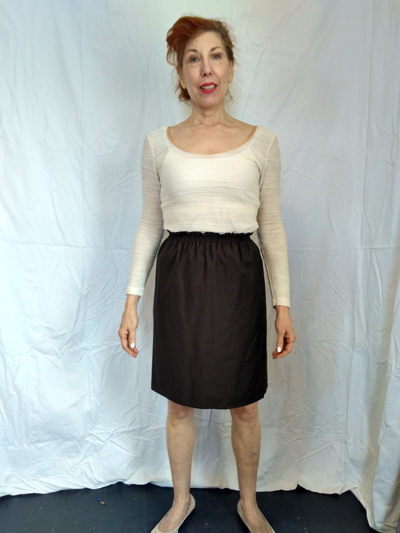 Cute brown wool skirt by Zoran. Made in USA.
