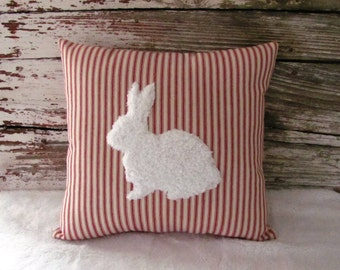 rabbit pillow white fur red ticking stripe