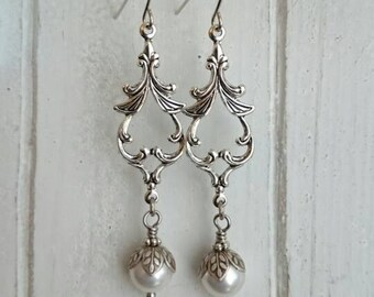 Long Dangle earrings - antique silver ox over brass attached with crystal pearl.