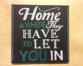 """Hand painted canvas typography: """"Home is where they have to let you in"""" black canvas sign"""