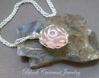Egg-Shaped Rose Quartz Wrapped in Sterling Silver Pendant