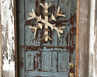 Distressed wooden winter snowflake