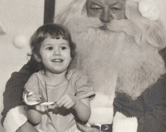 Vintage Photograph Small Girl With Candy Cane on Santa Claus' Lap 1960s