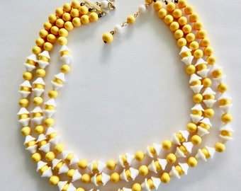 Triple Strand Japan Yellow Plastic and Milk Glass Necklace