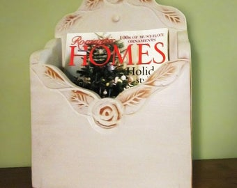 Magazine rack or mail holder.