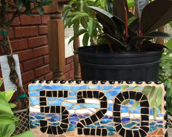 This broken tile ceramic mosaic this is a fun new way of displaying your house number!