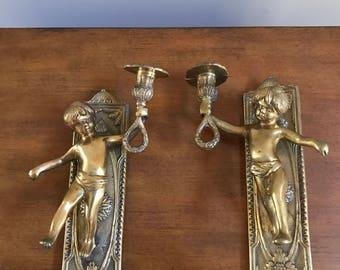 Vintage brass hanging cherub candlestick set
