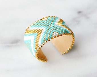 Gold, turquoise, and white chevron beaded cuff bracelet