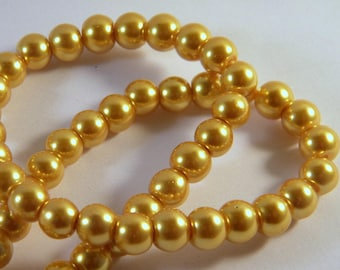 50 glass beads 8 mm Golden PV58