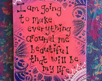 Beautiful stencilled pink and purple word art, positivity painting