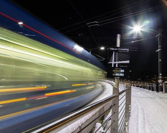 The MAX line powering through the snow across the Tilikum Bridge during the Portland snow storm of 2017