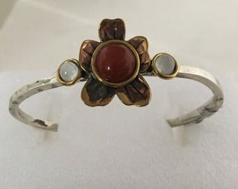 Sterling silver cuff bracelet with brass flower and carnelian and mother of pearl stones