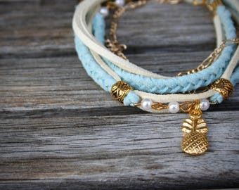 Wrap women's bracelet , gold charm (elephant, feather, pineapple), gold chain, braided light blue and beige suede.-BRA58