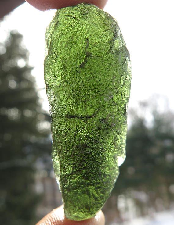 A beauty 25.5 gram Tear drop Moldavite with no damage. From the Czech Republic.