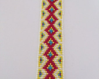 Cuff is hand woven seed beads.