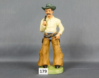 Western Cowboy statue Chaps Hat Belt Six shooter Fringed shirt Blue eyes Mustache Made in Taiwan