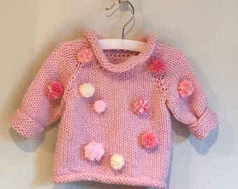 baby sweater pompom party in pink