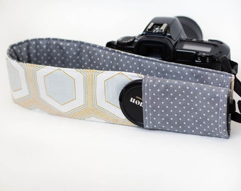 DSLR camera strap cover with lens cap pocket.  gold and silver hexagons with dots.